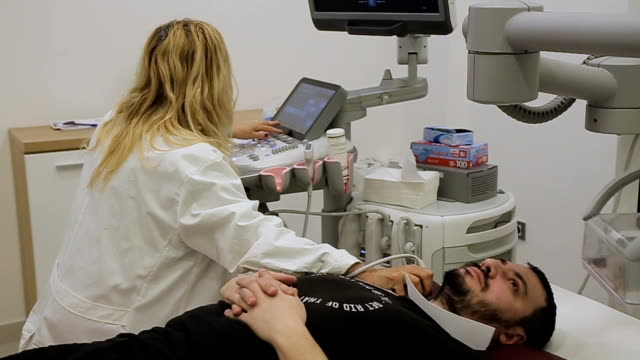 ultrasound examination of the arteries on the neck video