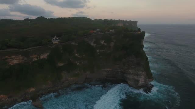 Uluwatu Temple aerial view at sunset