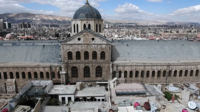 Umayyad Mosque in Damascus in aerial view, under the blue sky. Beautiful heritage of Syria, wonderful religious building in the middle of an ancient city Aerial view with a drone of the Umayyad Mosque in Damascus, under the blue sky. Beautiful heritage of Syria, wonderful religious building in the middle of an ancient city damascus stock videos & royalty-free footage