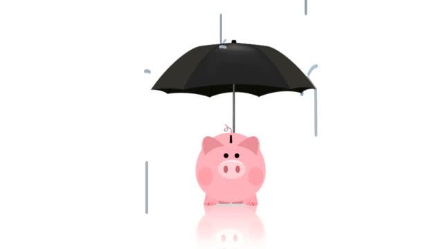 vídeos de stock e filmes b-roll de umbrella cover piggy bank - guarda chuva
