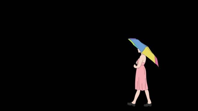 傘の女はアルファとサイドアニメーションを歩く - レインボー点の映像素材/bロール