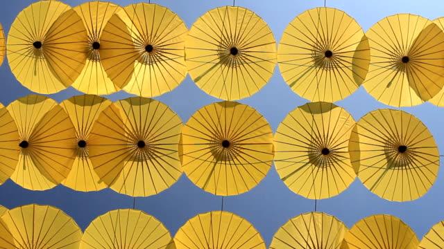 umbrellas in blue sky video