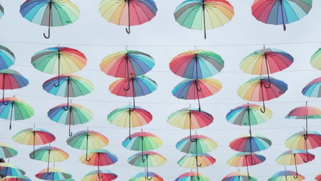 Umbrellas sway in the wind