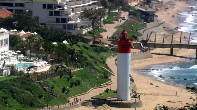 Umhlanga Rocks  - Aerial View - KwaZulu-Natal,  eThekwini Metropolitan Municipality,  Ethekwini,  South Africa This clip was filmed by Skyworks on HDCAM SR 4:4:4 using the Cineflex gimbal. KwaZulu-Natal,  eThekwini Metropolitan Municipality,  Ethekwini South Africa natal stock videos & royalty-free footage