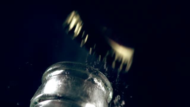 Uncapping the bottle. Super slow motion