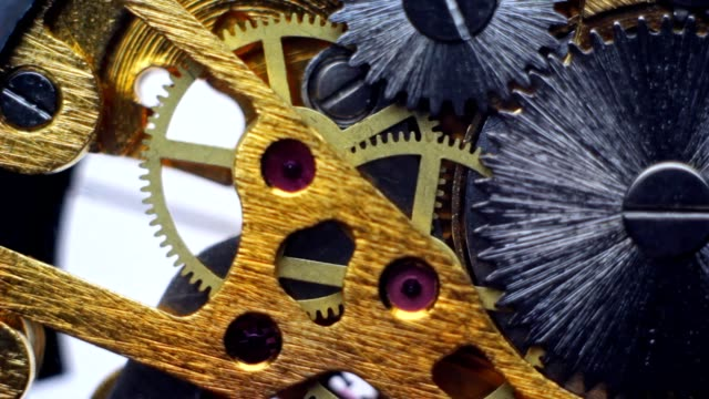 Uncovered gears of the clock and clock mechanism video