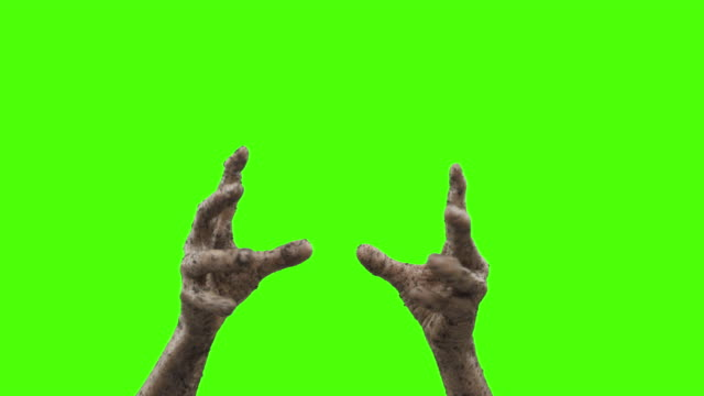 vídeos de stock e filmes b-roll de undead - hands and forearms of a zombie who is rising from the dead - halloween