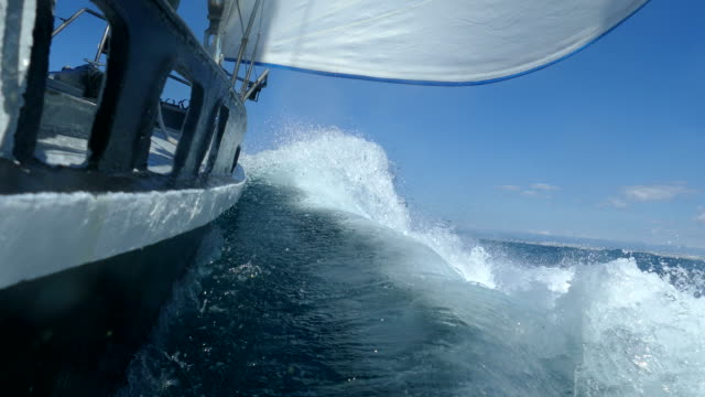 Under the sails of a racing yacht in a storm video