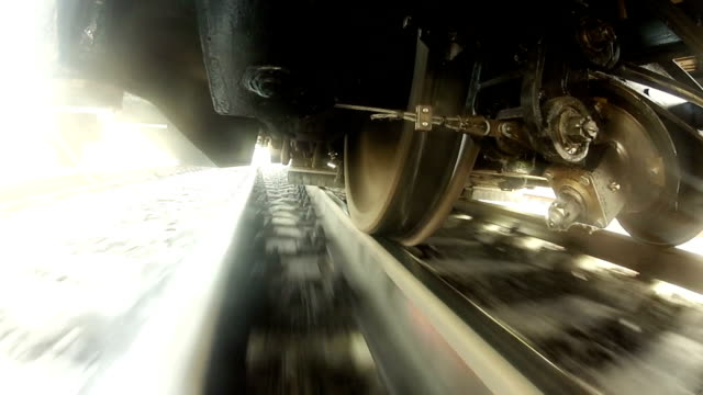 Under the train Railroad and wheels of moving train. wheel stock videos & royalty-free footage