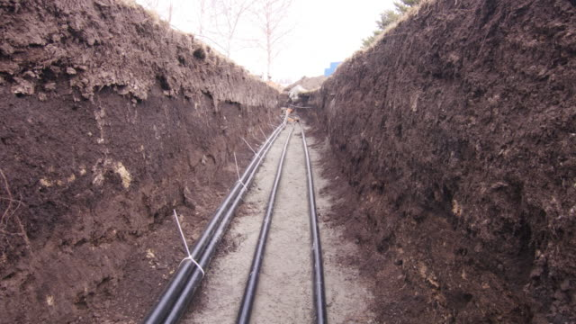 Underground high voltage energy cable laying in trench video