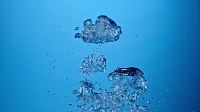 SLO MO Underwater air pockets on blue background video