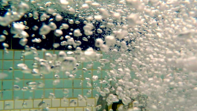 underwater bubbles from pool water
