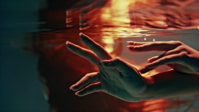 Underwater dance. Delicate touch