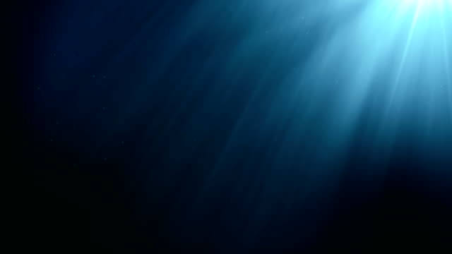 underwater seamless scene with air bubbles floating up and sun shining through the water. - subacqueo video stock e b–roll