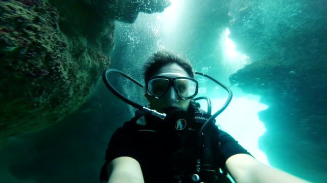 Underwater selfie on a cave Woman selfie in underwater cave scuba diving stock videos & royalty-free footage