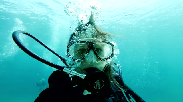 Underwater selfie Scuba girl doing an underwater selfie scuba diving stock videos & royalty-free footage
