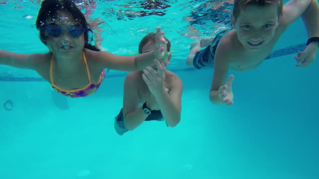 Underwater shot of kids in pool Underwater shot of kids in pool swimming stock videos & royalty-free footage