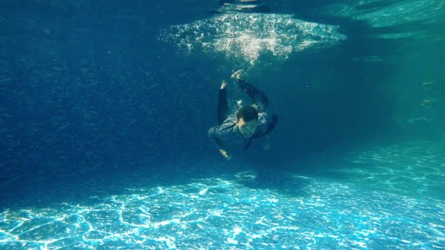 Underwater swimming in swimming pool video