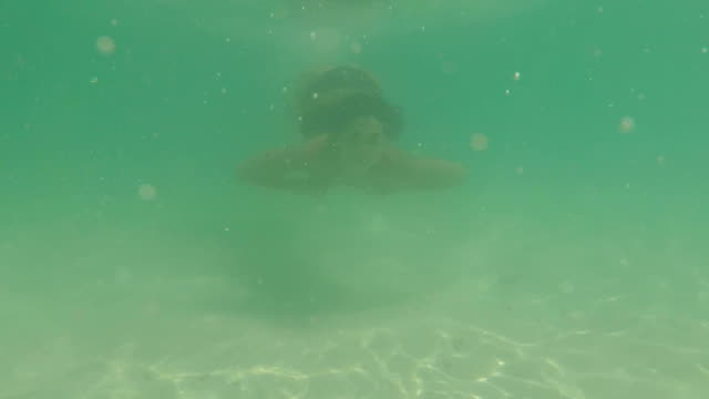 Underwater View Of Woman Swimming Under Water In Sea Action Camera POV Young Girl In Bikini On Beach video