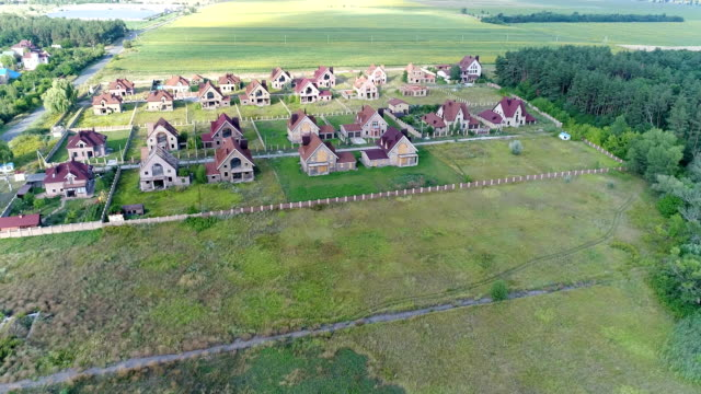 Unfinished cottages, abandoned cottages, a cottage town, several houses, Green lawn, View from above, aerial Unfinished cottages, abandoned cottages, a cottage town, several houses, Green lawn, View from above incomplete stock videos & royalty-free footage