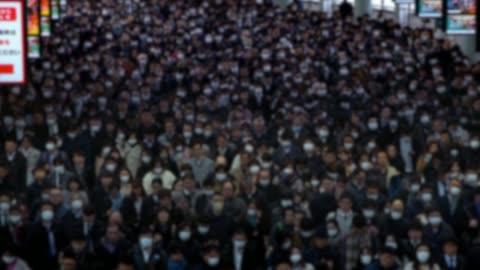 vidéos et rushes de 4k, personnes non focalées portant le masque par mesure de précaution coronavirus - japon