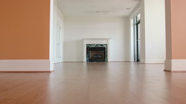 Unfurnished Living Room Dolly shot of an unfurnished living room. living room stock videos & royalty-free footage