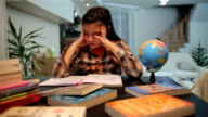 istock Unhappy child working on hard homework at home alone 898767848
