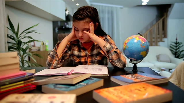Unhappy child working on hard homework at home alone Unhappy child working on hard homework at home alone primary school stock videos & royalty-free footage