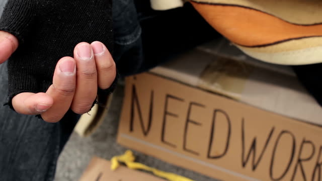 Unhappy lonely man begging on the street, in need of work, poverty and indigence video
