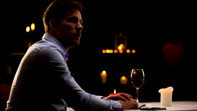 Unhappy man blowing out candles and leaving restaurant, unsuccessful date Unhappy man blowing out candles and leaving restaurant, unsuccessful date relationship breakup stock videos & royalty-free footage