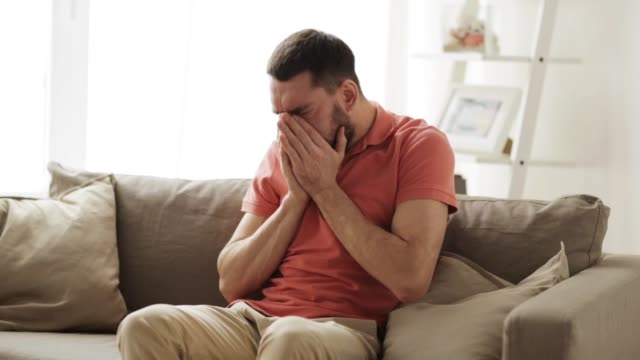 unhappy sick man coughing at home people, healthcare and health problem concept - unhappy man coughing at home coughing stock videos & royalty-free footage
