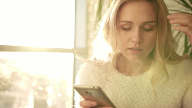 Unhappy woman texting message on mobile. Annoyed woman with smartphone