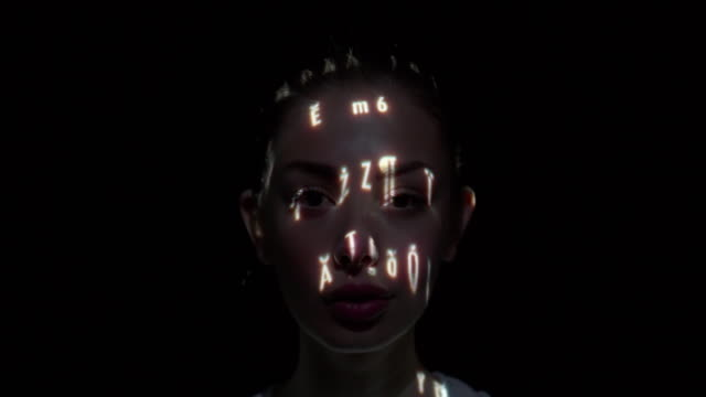 Unicode characters projected on a woman's face