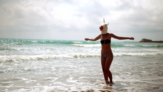 Unicorn having fun on the beach video