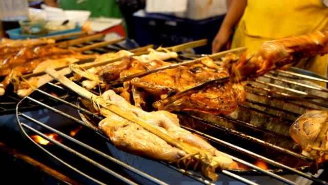 unidentified man cooking roast chicken video