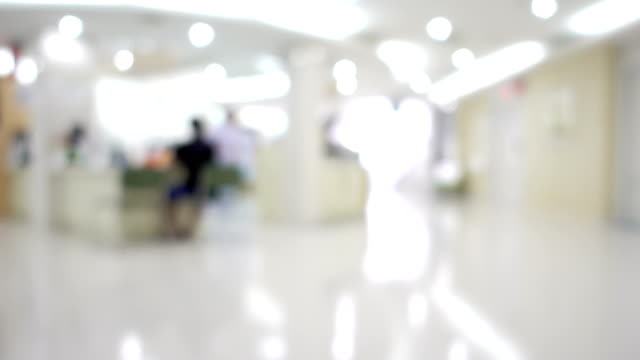 Unidentified medical personnel and patient in hospital Still shot of blurred unidentified medical personnel and patient in hospital for background use. medical building stock videos & royalty-free footage