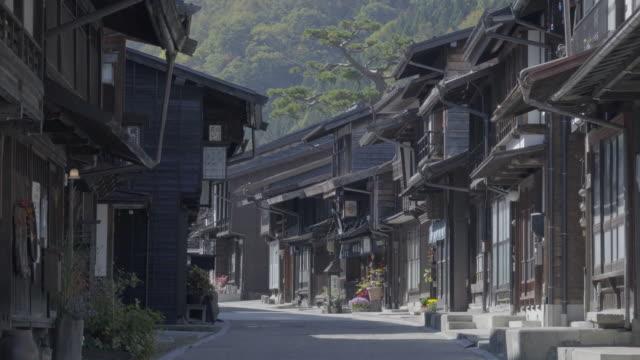 Unidentified people visit Narai Post town, Japan Old wooden house and narrow street in Kiso Valley of Nagano ,Japan.(Narai-Juku)