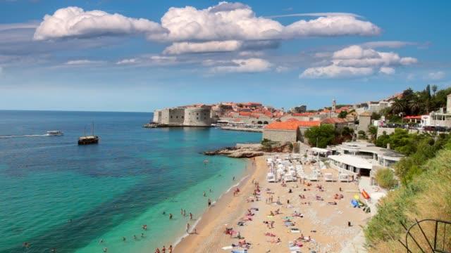 unidentified persons on beach in dubrovnik, croatia. - хорватия стоковые видео и кадры b-roll