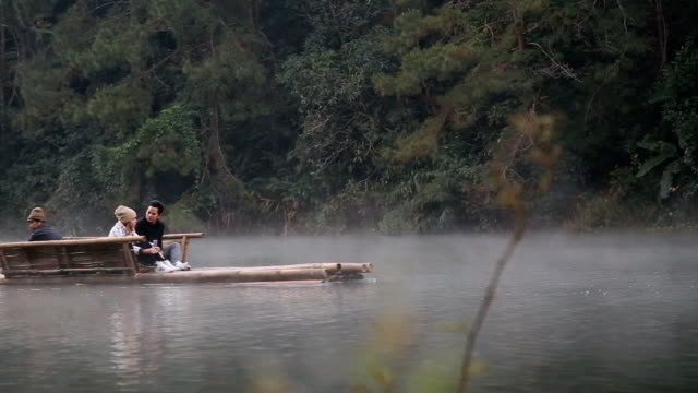 Unidentified tourists on bamboo raft in the morning at Pang Ung video