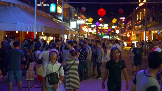 unidentified tourists walking in pub street at siem reap, cambodia - cambogia video stock e b–roll