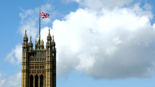 Union Flag flying over UK parliament building. video