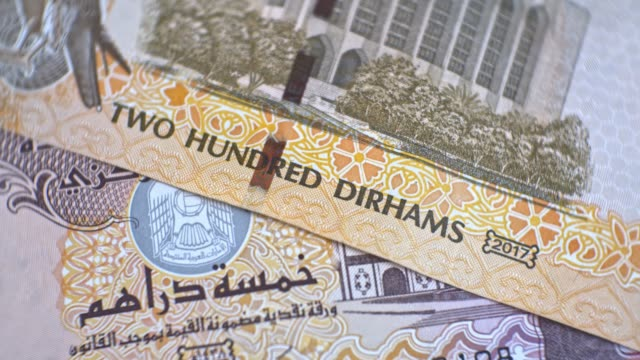 united arab emirates 200 dirham banknote, uae emirati money closeup - cartello economico video stock e b–roll