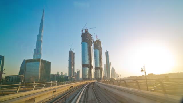 united arab emirates dubai city downtown sunset metro line ride panorama 4k time lapse video