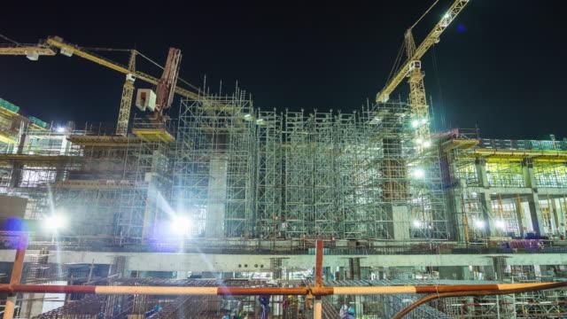 united arab emirates dubai city jumeirah beach road night light working construction panorama 4k time lapse uae video