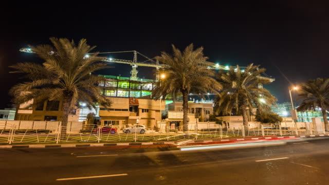 united arab emirates dubai jumeirah traffic road hotel working construction panorama 4k time lapse uae video