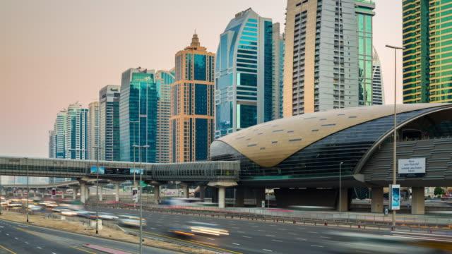 united arab emirates dubai marina sheikh zayed road sunset jlt metro station panorama 4k time lapse video