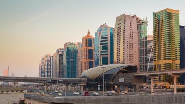 united arab emirates dubai marina sheikh zayed traffic road sunset jlt metro station panorama 4k time lapse video