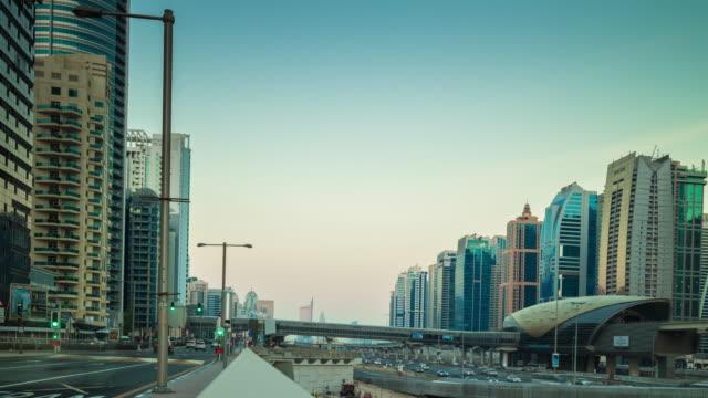 united arab emirates dubai marina sunset traffic main road tram line panorama 4k time lapse video