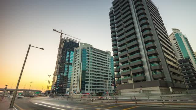 united arab emirates dubai marina sunset twilight sheikh zayed road panorama 4k time lapse video