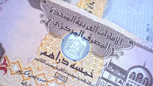 united arab emirates five dirham banknote, uae emirati money closeup - cartello economico video stock e b–roll